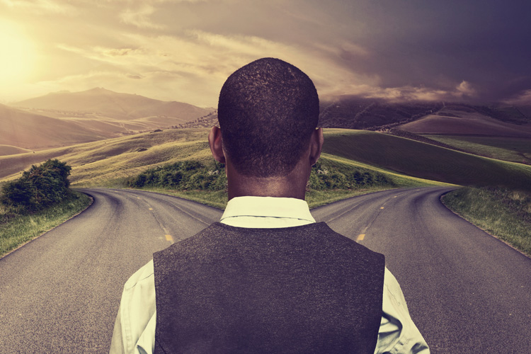 young-man-standing-at-crossroads